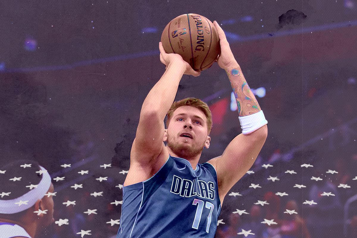 Luka Doncic attempts a jump shot in the preseason.