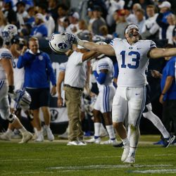 Brigham Young fullback Masen Wake (13) celebrates after winning against Arizona State during an NCAA college football game at LaVell Edwards Stadium in Provo on Saturday, Sept. 18, 2021.