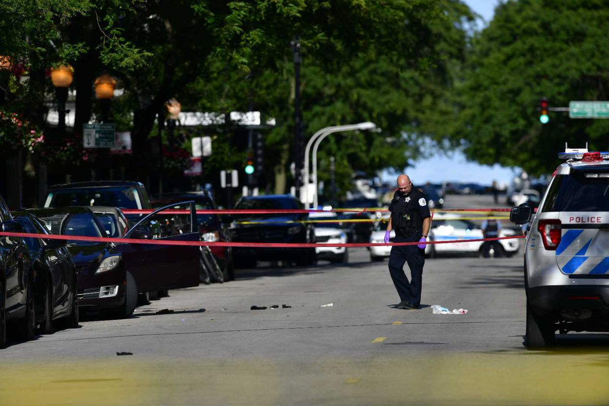 Chicago police investigate the scene where three people were shot Aug. 4, 2020, in the Gold Coast neighborhood.