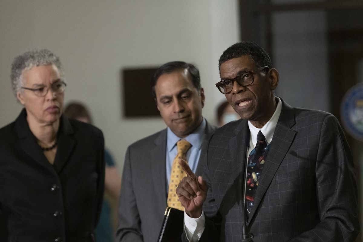 Dr. Terry Mason, chief operating officer for the Cook County Department of Public Health, right, along with Cook County Board President Toni Preckwinkle, left.