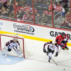 Stuart and Ovechkin Race for Puck