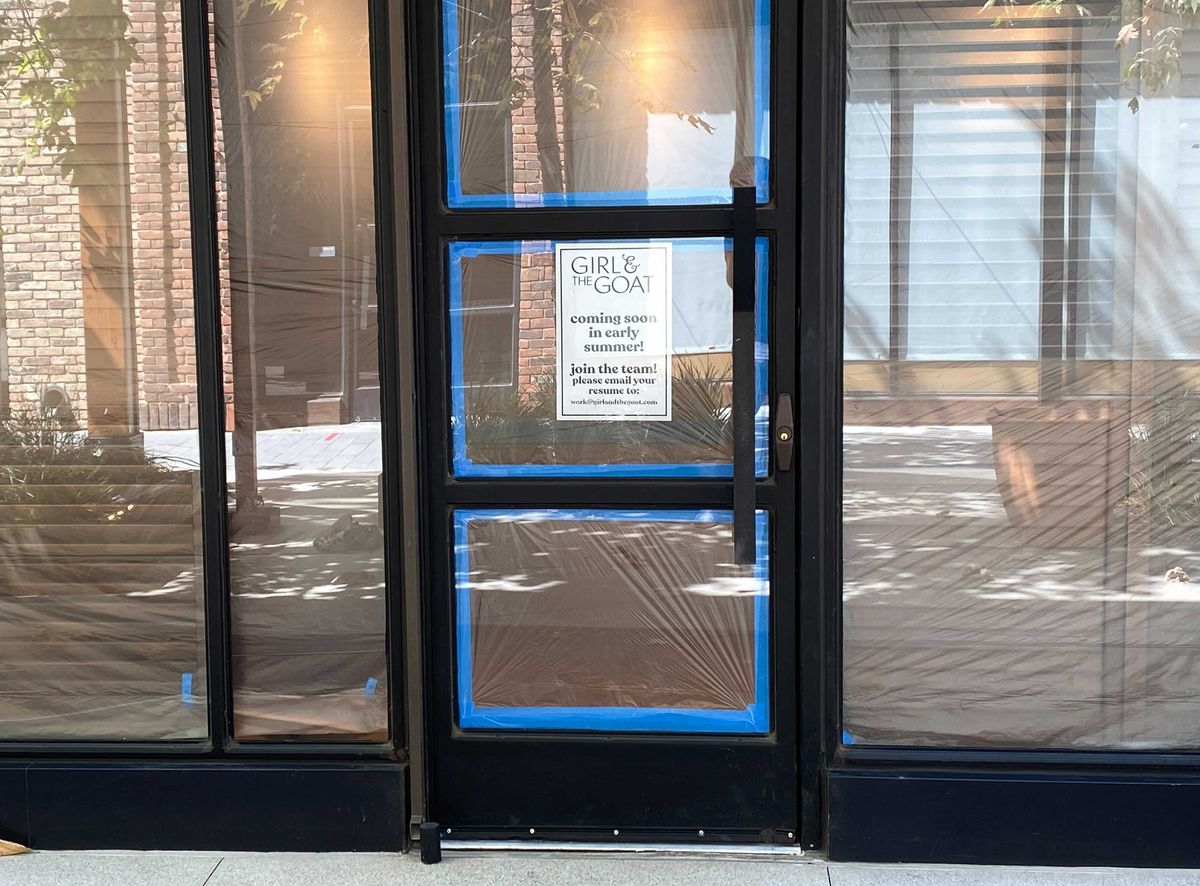 Signage for Girl and the Goat, a forthcoming Arts District restaurant wrapped in steel and brick and glass.