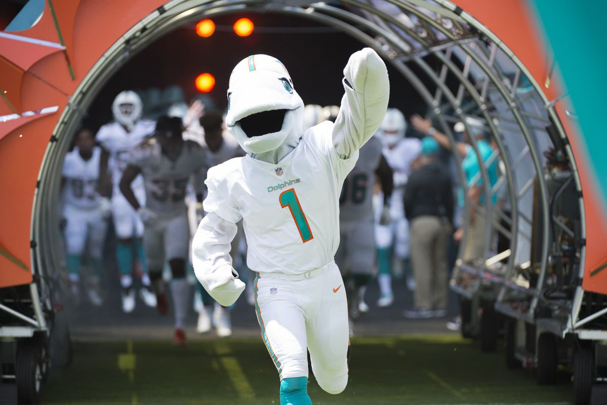 T.D. the Miami Dolphins mascot leads the players onto the field during the NFL football game between the Tennessee Titans and the Miami Dolphins on September 9, 2018, at the Hard Rock Stadium in Miami Gardens, FL.