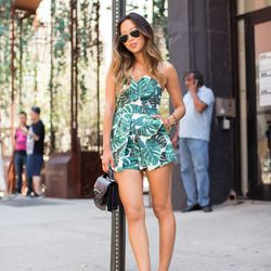 """Aimee of <a href=""""http://www.songofstyle.com""""target=""""_blank"""">Song of Style</a> is wearing Ray-Ban sunglasses, a <a href=""""http://us.topshop.com/en/tsus/product/clothing-70483/rompers-and-jumpsuits-2281954/palm-bandeau-skort-playsuit-2917702?bi=1&ps=200&geo"""