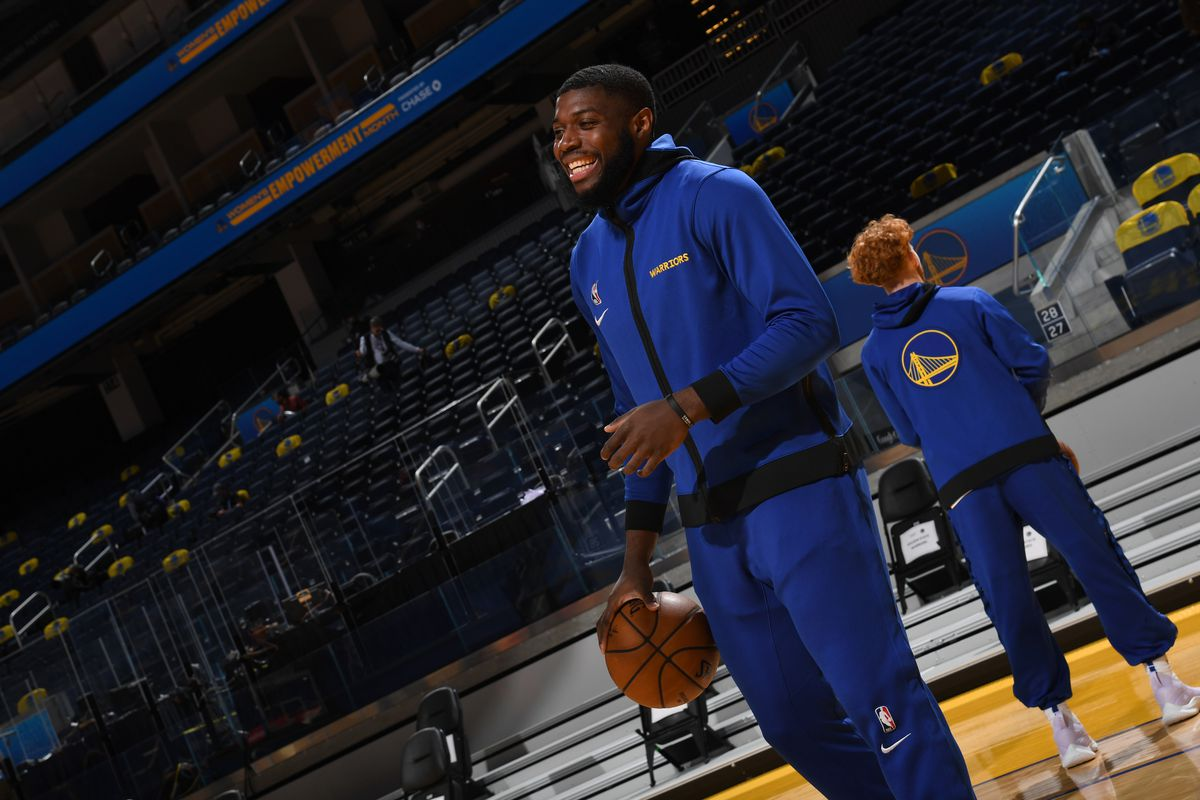 Eric Paschall #7 of the Golden State Warriors smiles before the game against the Atlanta Hawks on March 26, 2021 at Chase Center in San Francisco, California.