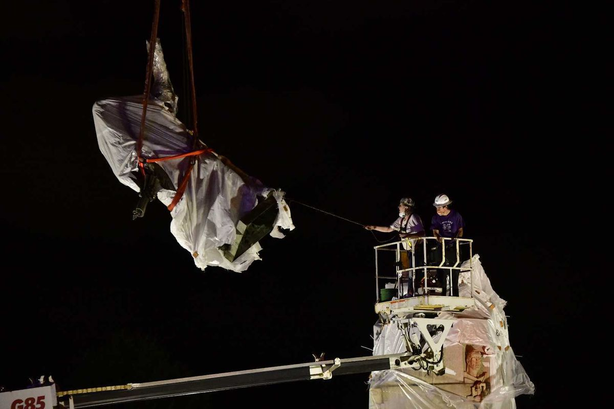 The statue of Christopher Columbus in Grant Park was removed about 3 a.m. July 24, 2020.