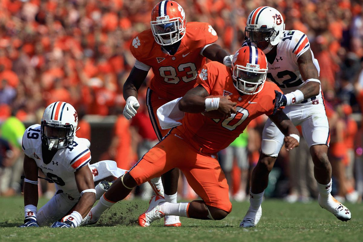 CLEMSON, SC - SEPTEMBER 17:  Tajh Boyd #10 of the Clemson Tigers is tackled by Demetruce McNeal #12 of the Auburn Tigers during their game at Memorial Stadium on September 17, 2011 in Clemson, South Carolina.  (Photo by Streeter Lecka/Getty Images)
