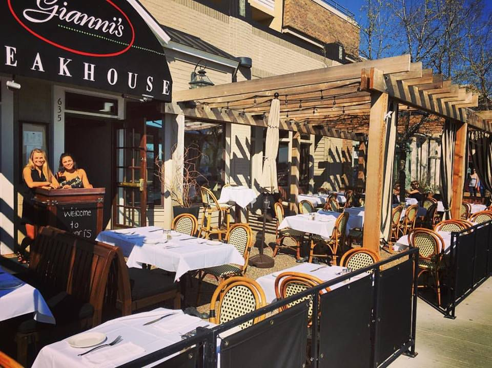 The exterior of Gianni's with a pergola over a sidewalk patio