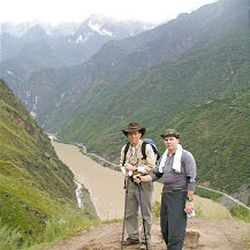 Michael and James Sneddon pause in Tiger Leaping Gorge during a search in September. Apparently David successfully hiked the area.