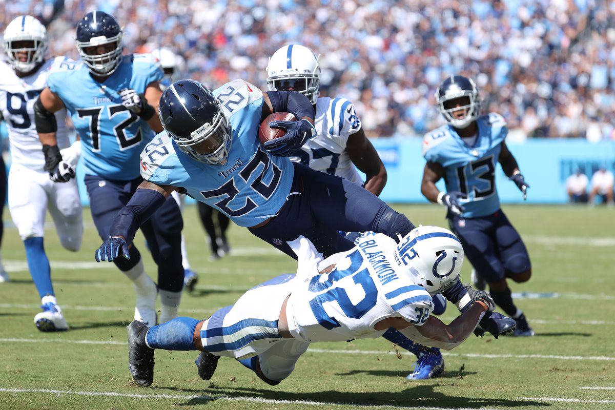 Derrick Henry #22 of the Tennessee Titans runs with the ball against the Indianapolis Colts at Nissan Stadium on September 26, 2021 in Nashville, Tennessee