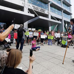 Ben Frank, right, speaks as people gather in Salt Lake City on Tuesday, June 27, 2017, to rally against a Senate GOP health care bill.