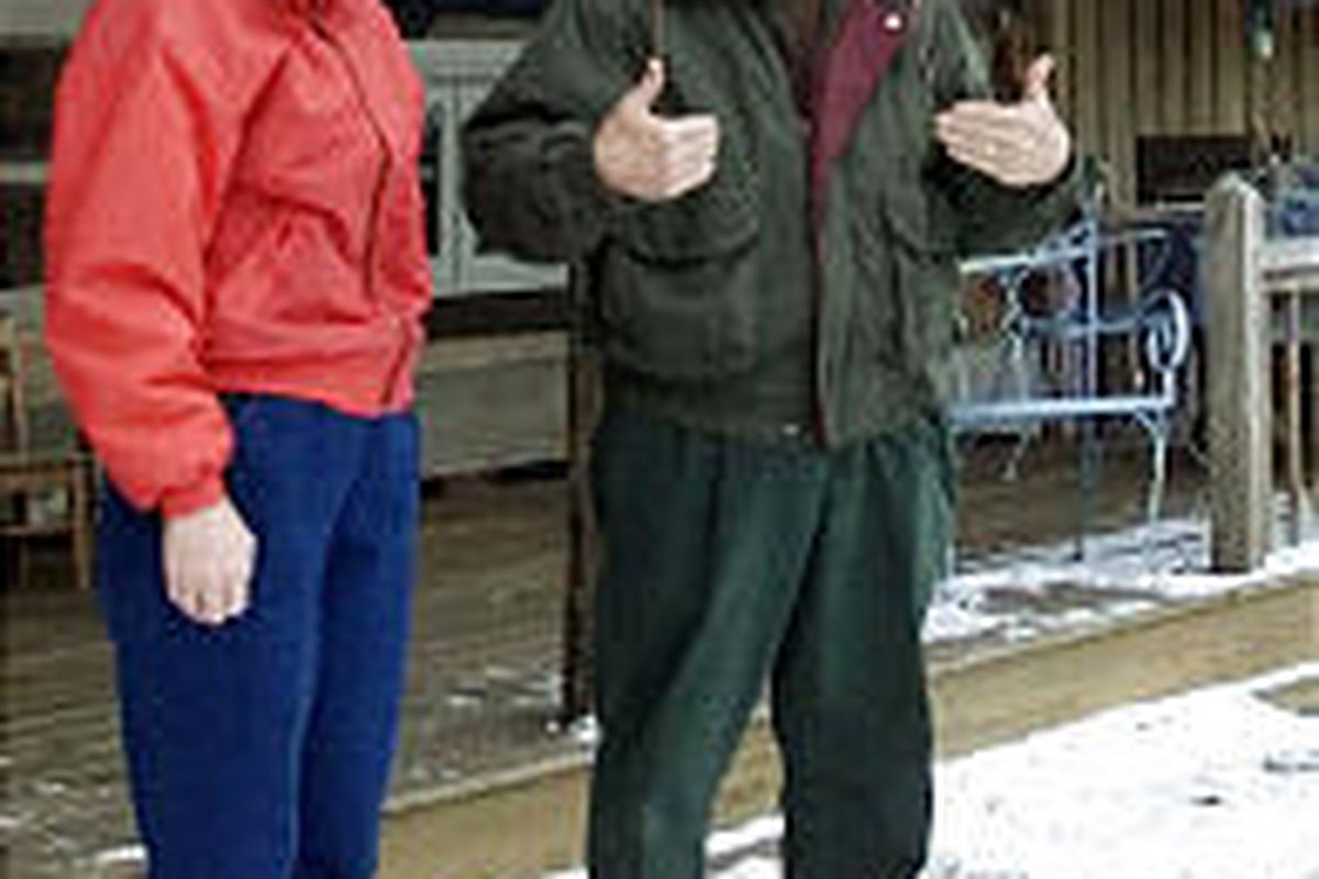 Indiana Gov. Frank O'Bannon and his wife, Judy, are shown in a file photo from Dec. 27, 2000, in front of their home in Corydon, Ind. The first lady flew to Chicago Monday, Sept. 8, 2003, with daughter Jennifer to be at her husband's side at Northwestern