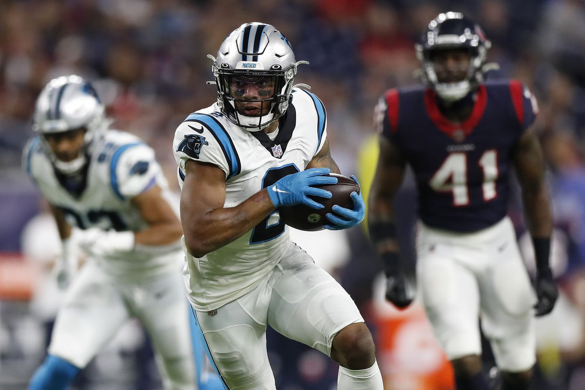 D.J. Moore #2 of the Carolina Panthers looks for yards after a first quarter catch while playing the Houston Texans at NRG Stadium on September 23, 2021 in Houston, Texas.