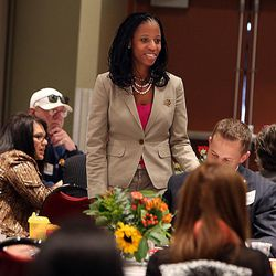 Congressional hopeful Mia Love chats with guests at a town hall luncheon at Salt Lake Community College's Miller Free Enterprise Conference Center in Sandy on Wednesday, Nov. 13, 2013.