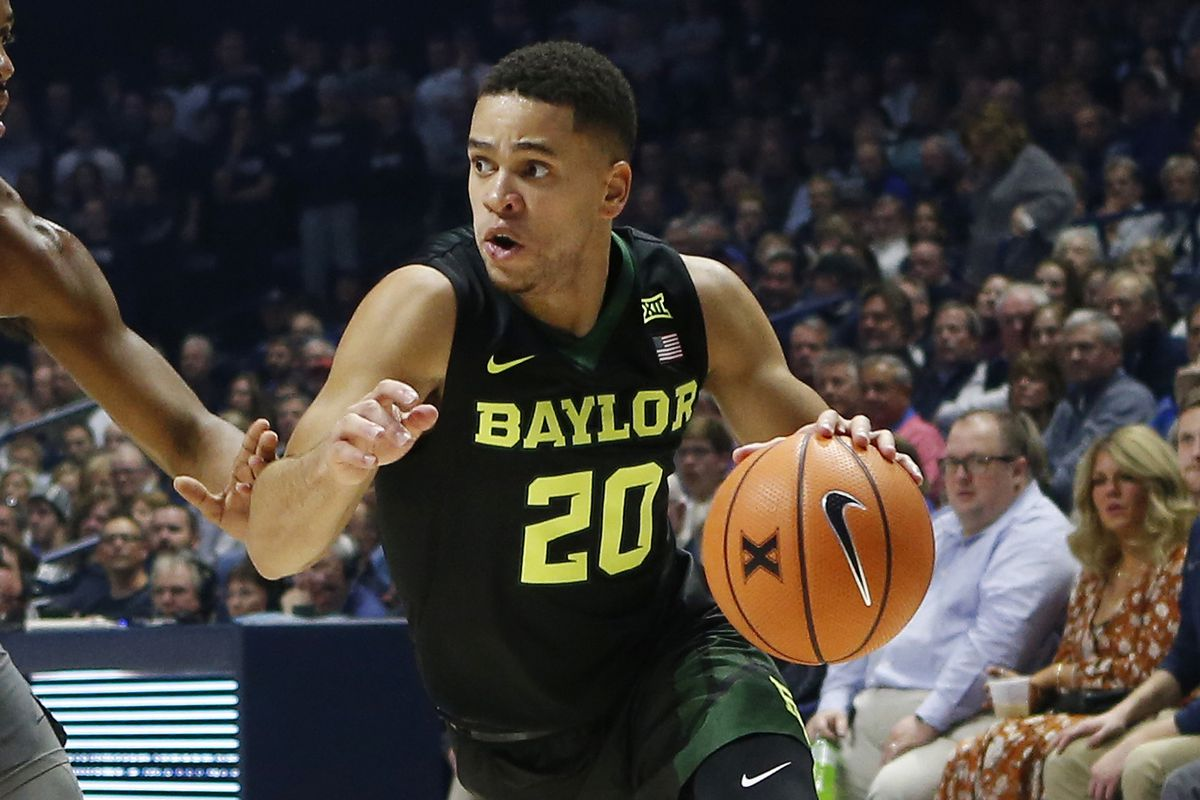 Nov 28, 2017; Cincinnati, OH, USA; Baylor Bears guard Manu Lecomte (20) goes to the basket against Xavier Musketeers guard Paul Scruggs (1) during the first half at the Cintas Center. Mandatory Credit: Frank Victores-USA TODAY Sports