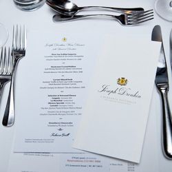 The evening's menu and wine information