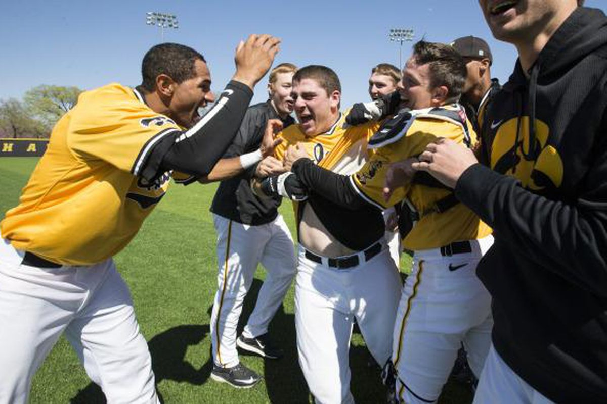 Happy Hawkeyes celebrate another walk-off win.