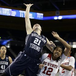 BYU's Lexi Eaton (21) gets a rebound against North Carolina State's Krystal Barrett (12) during the first half of a first-round game in the NCAA women's college basketball tournament on Saturday, March 22, 2014, in Los Angeles. (AP Photo/Jae C. Hong)