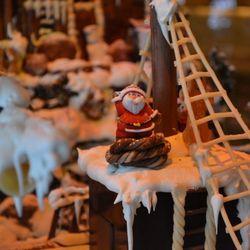 A marzipan Santa rides the gingerbread pirate ship.