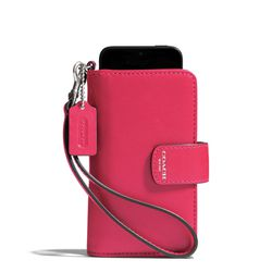 """<a href=""""http://f.curbed.cc/f/Coach_111913_Wristlet"""">Legacy Phone Wristlet in Pink Scarlet</a>, $88"""