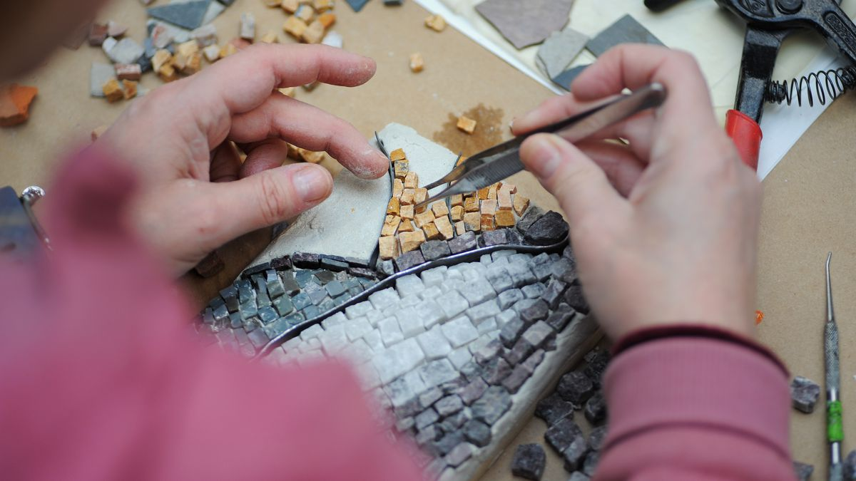 A student works on a mosaic at the Chicago Mosaic School in Edgewater.