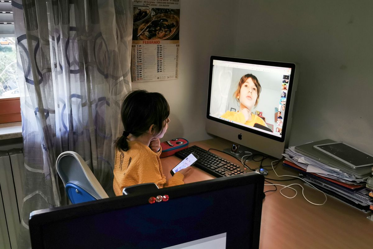 A student in Italy connects with her teacher and classmates online to recover lost instruction while schools are closed due to the new coronavirus.