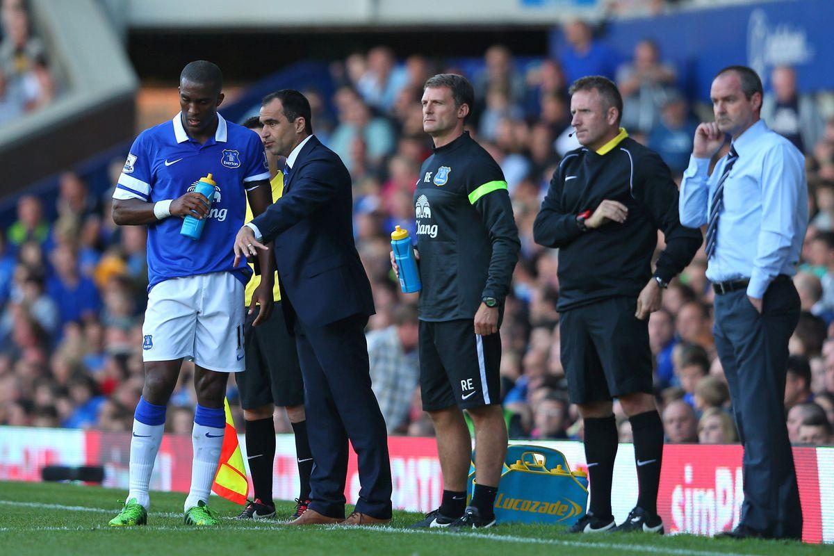 Roberto Martinez passes his instructions on to Sylvain Distin
