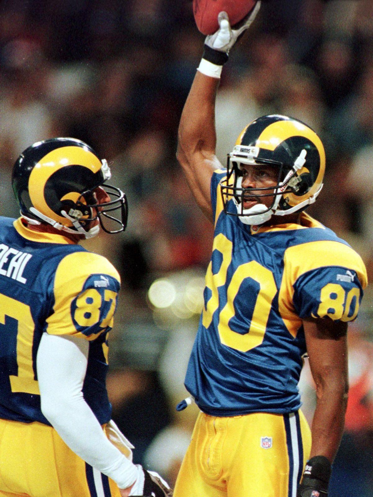 St. Louis Rams player Issac Bruce (R) celebrates h