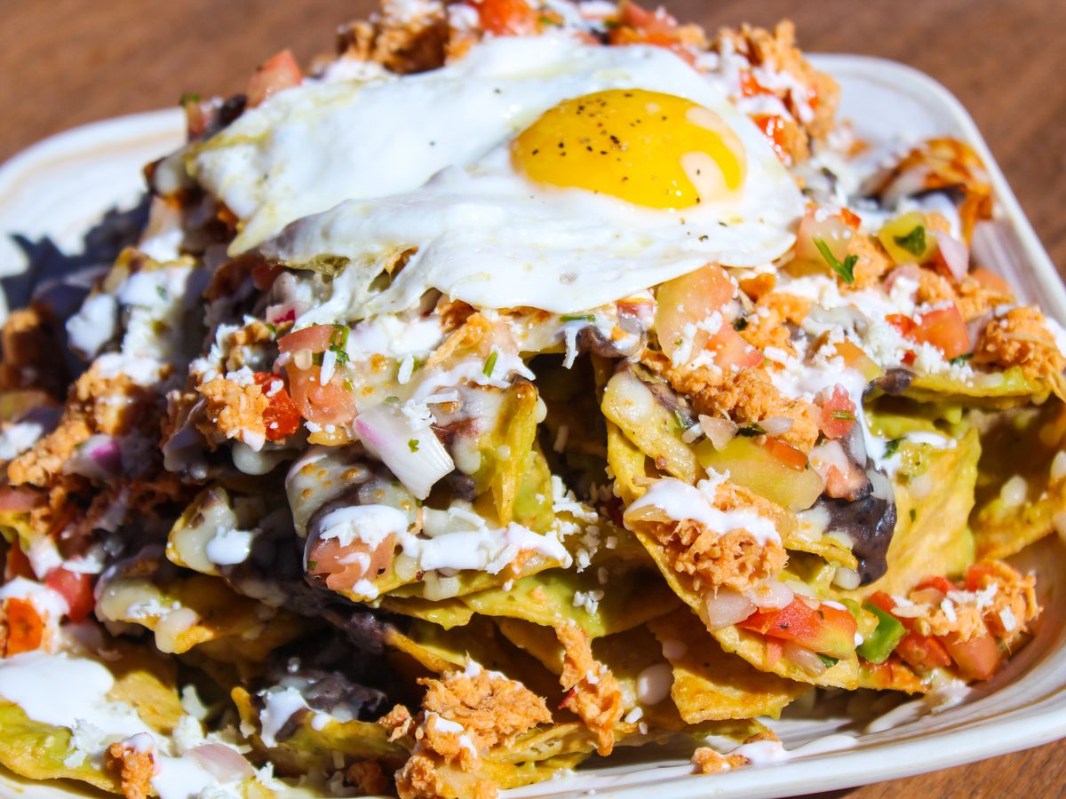 A plate of chilaquiles with an over-easy egg on top