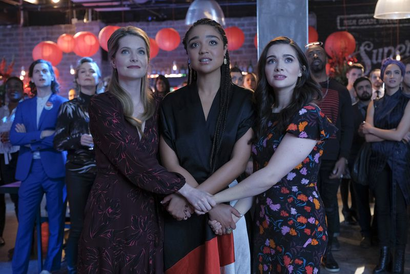 Meghann Fahy, Aisha Dee, and Katie Stevens waiting for Kat's election results to come in.
