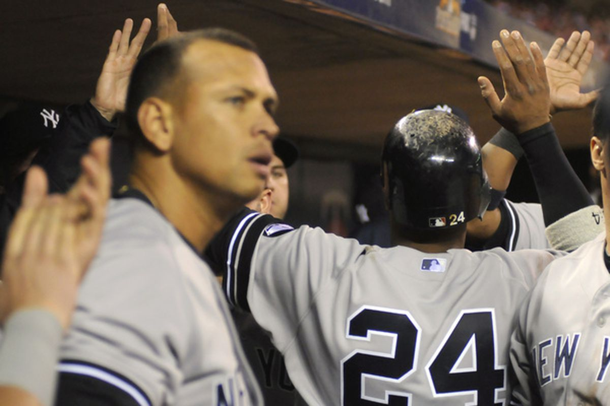 MINNEAPOLIS MN - OCTOBER 6: Robinson Cano #24 of the New York Yankees is welcomed back to the dugout after scoring during game one of the ALDS on October 6 2010 at Target Field in Minneapolis Minnesota. (Photo by Hannah Foslien /Getty Images)