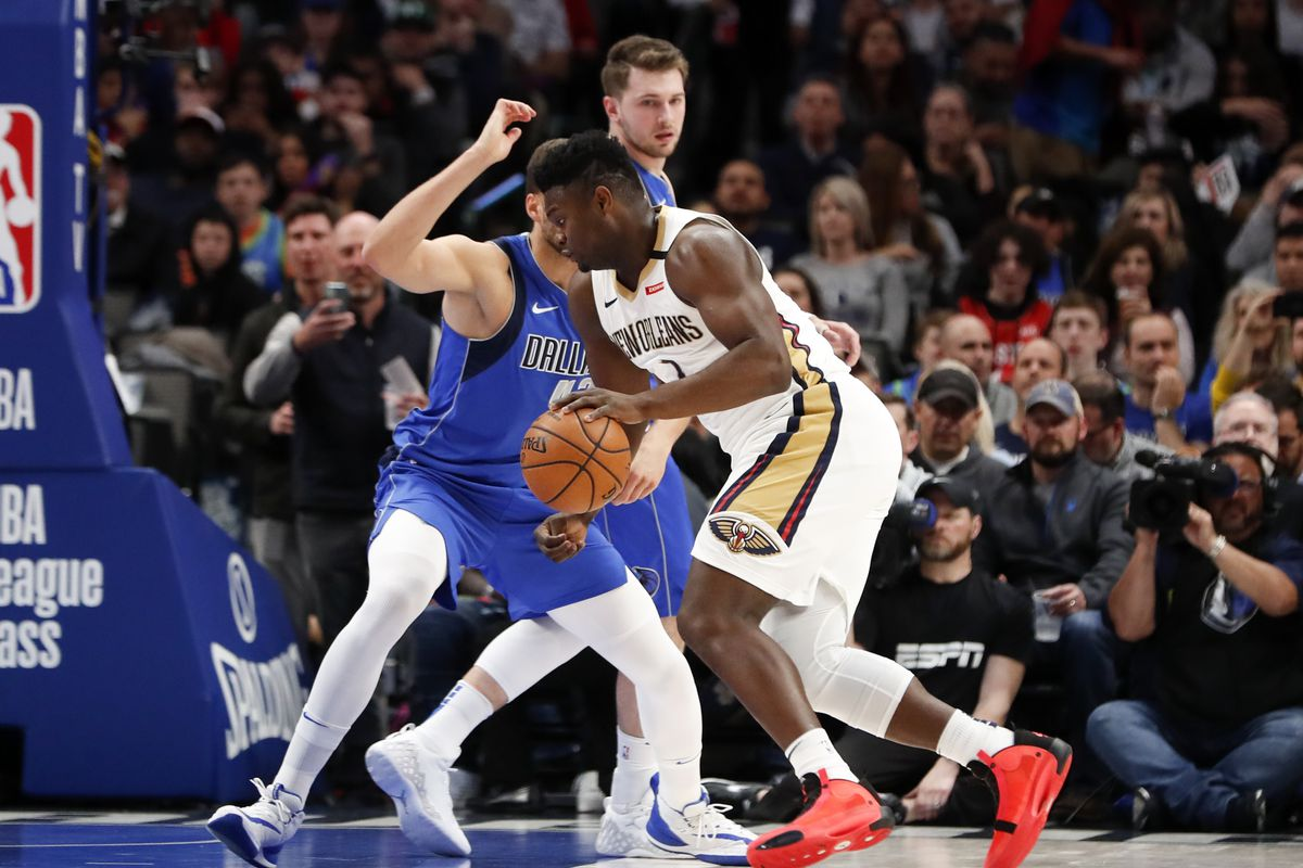 New Orleans Pelicans forward Zion Williamson drives to the basket as Dallas Mavericks forward Maxi Kleber defends during the first quarter at American Airlines Center.