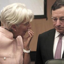 President of the European Central Bank Mario Draghi, left,  talks with the Managing Director of the IMF Christine Lagarde, prior of the Informal European economic and financial affairs council in capital Nicosia, Cyprus, Friday, Sept. 14, 2012.  European finance ministers are gathering in Cyprus for two days of discussions about the debt crisis and the latest developments in Greece and Spain.