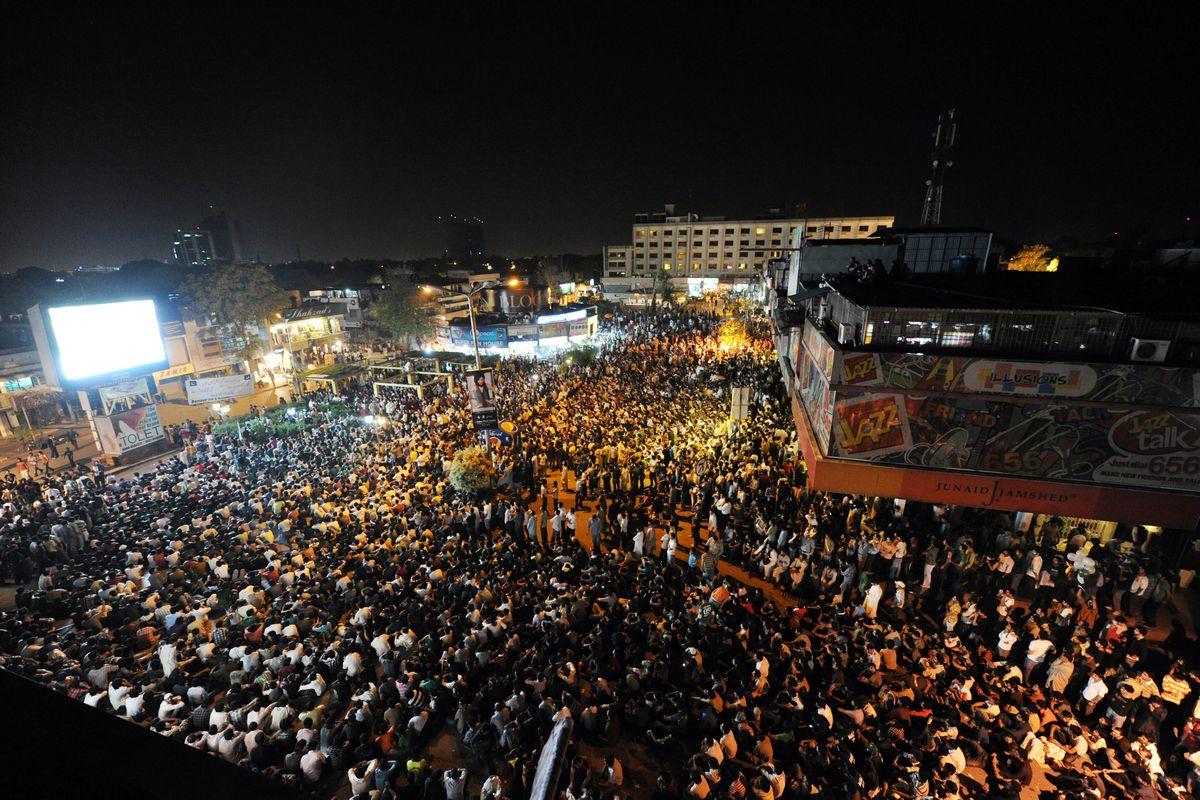 Pakistani cricket fans gather as they wa
