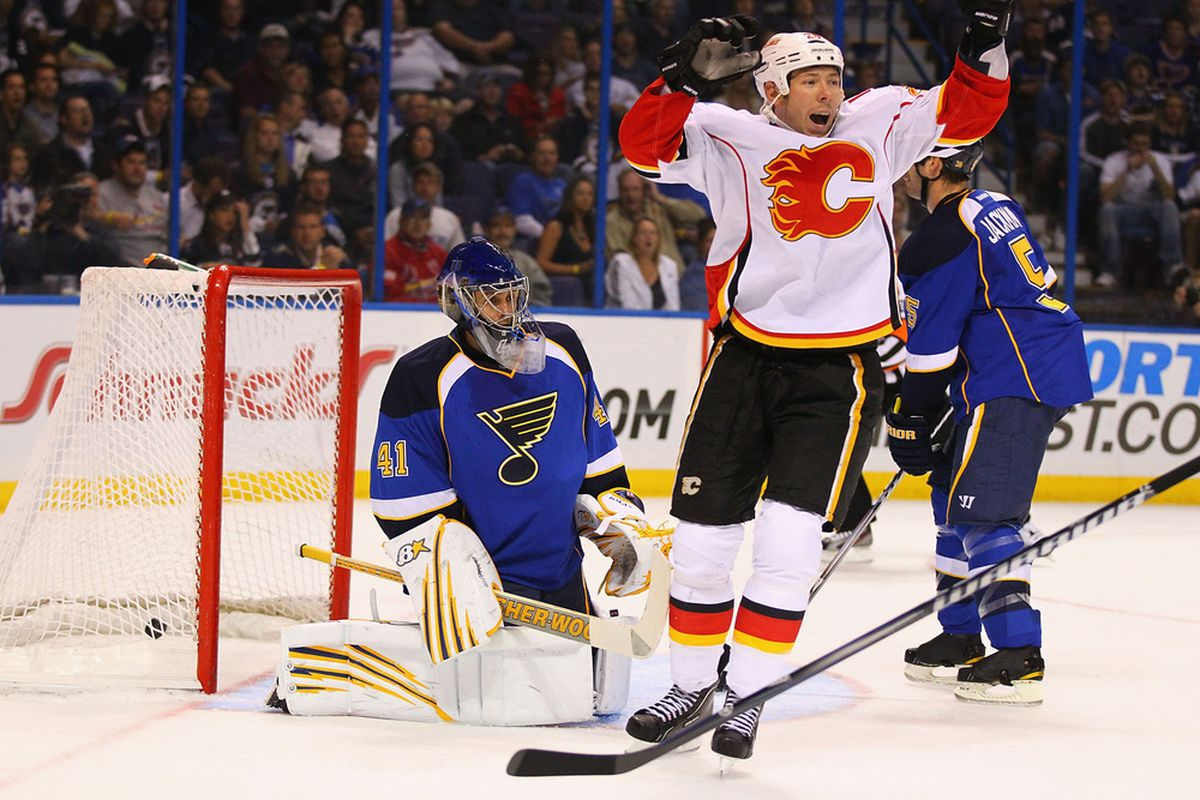ST. LOUIS, MO - OCTOBER 10: David Moss #25 of the Calgary Flames celebrates a goal against Jaroslav Halak #41 of the St. Louis Blues at the Scottrade Center  on October 10, 2011 in St. Louis, Missouri.  (Photo by Dilip Vishwanat/Getty Images)