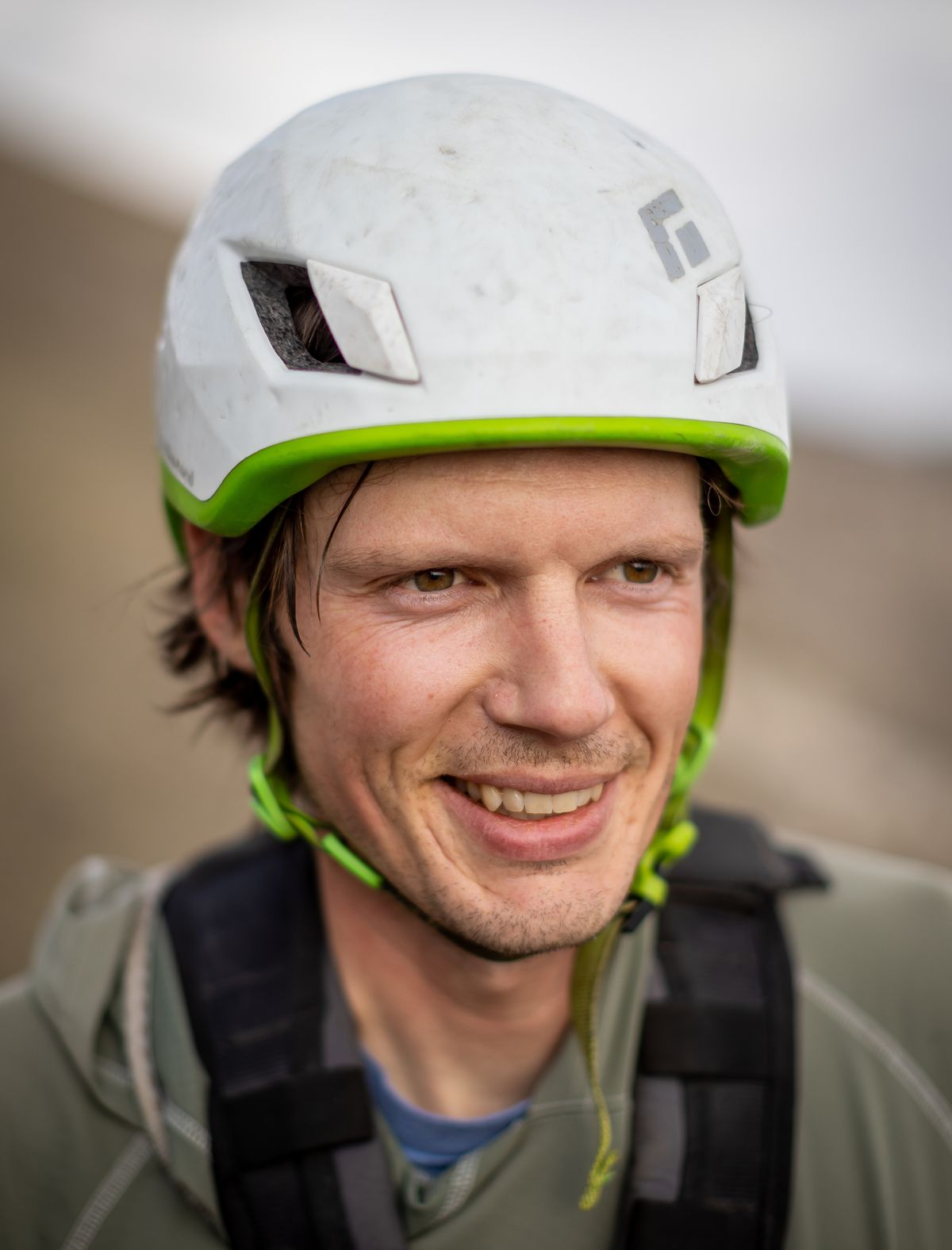 Hawkwatch International research associate Dustin Maloney poses for a photo after rappelling into a golden eagle nest in Tooele County on Friday, June 18, 2021.