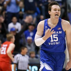 Brigham Young Cougars forward Payton Dastrup (15) celebrates after scoring a 3-pointer against the Utah Utes at the Marriott Center in Provo on Saturday, Dec. 16, 2017.