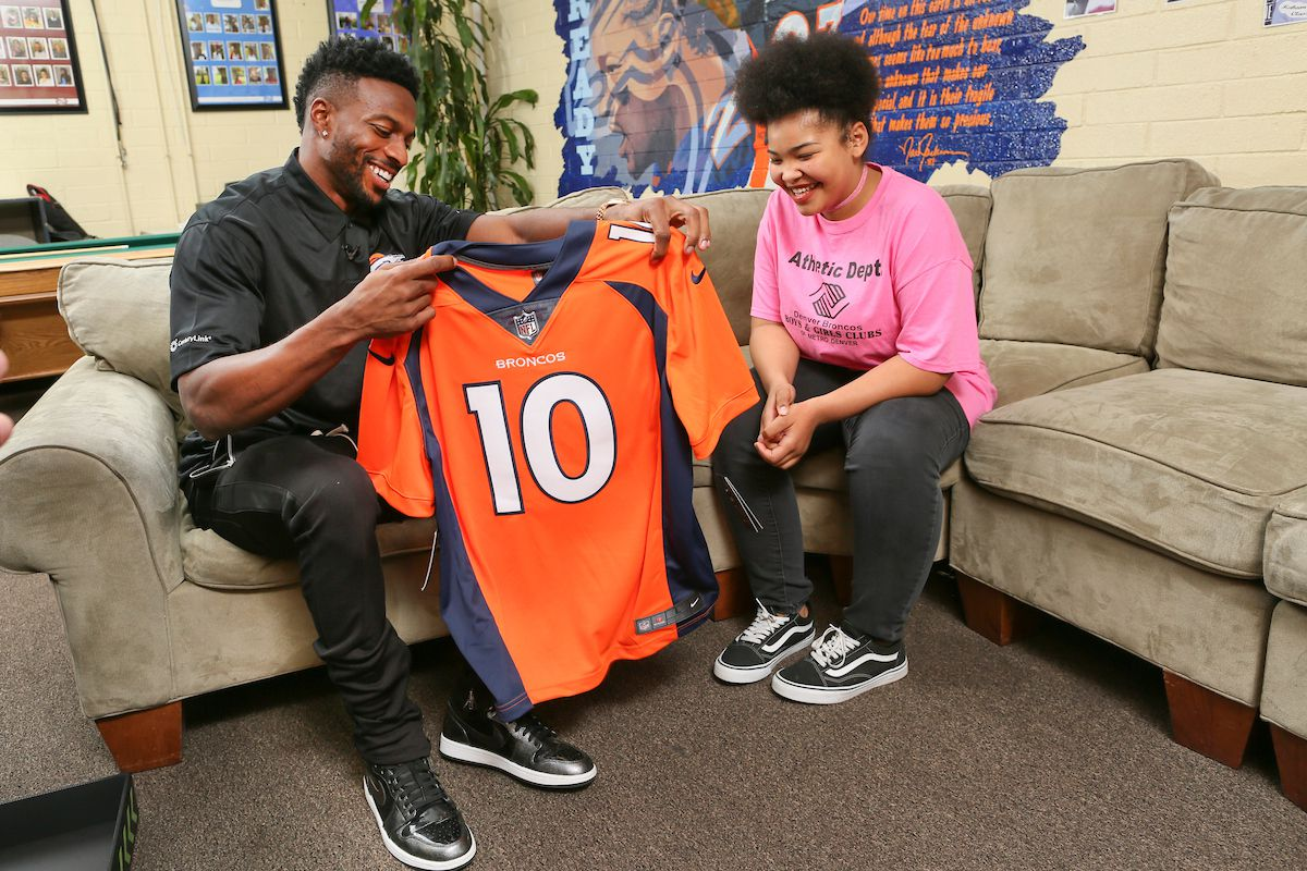 Emmanuel Sanders, wide receiver for the Denver Broncos,  teamed up with CenturyLink to present Foune Fofana, 13, a Boostbox filled with signed Broncos memorabilia, customized tablet and other tech gear on Tuesday, Nov. 28th at the Denver Broncos Boys and Girls Club in Denver, CO. (Barry Gutierrez/AP Images)