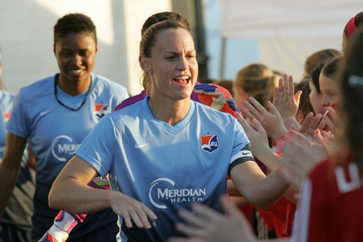 Christie Rampone giving out some high fives