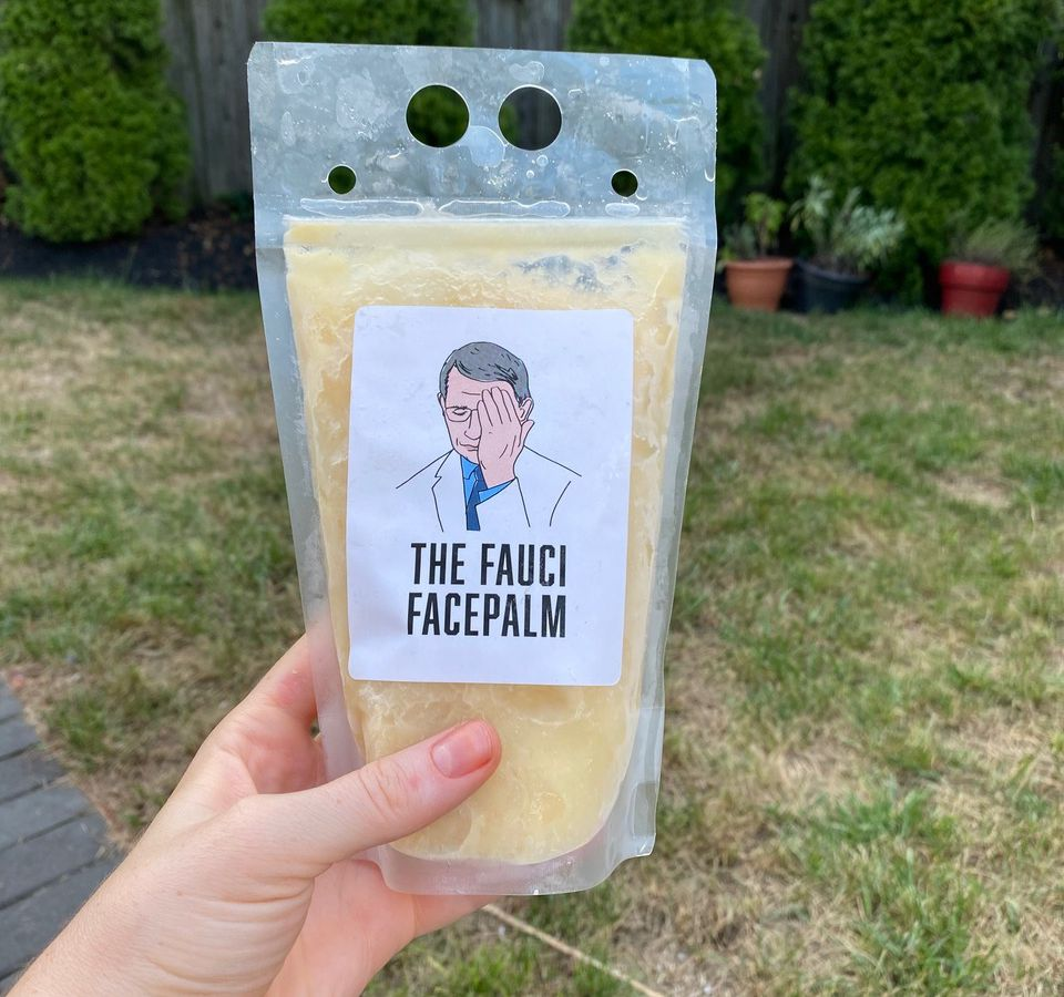 hand holding drink pouch with drawing of man and text reading the fauci facepalm