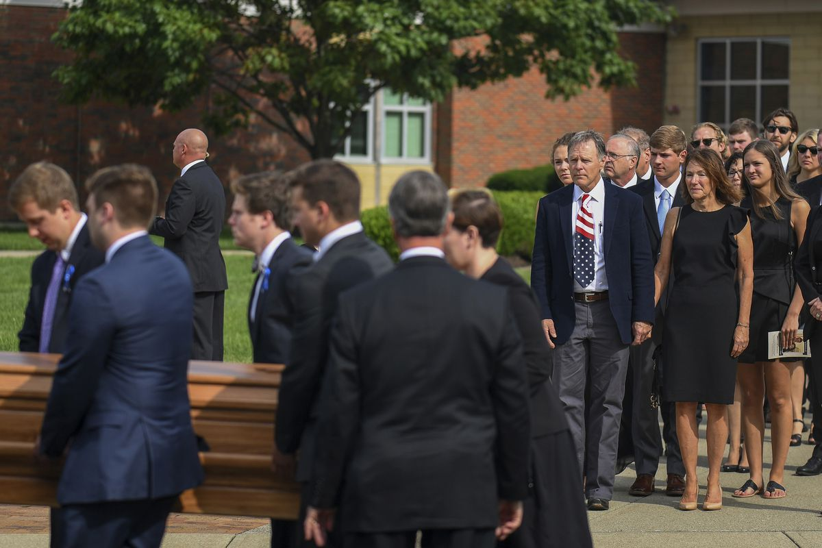 Fred and Cindy Warmbier watch as their son Otto, is placed in a hearse after his funeral, Thursday, June 22, 2017, in Wyoming, Ohio. Otto Warmbier, a 22-year-old University of Virginia student who was sentenced in March 2016 to 15 years in prison with har