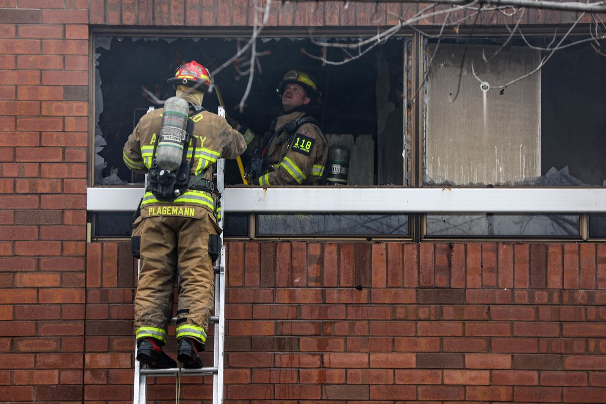 Unified Fire Authority firefighters check for hot spots at the scene of a fire at Union Center offices at 7001 S. 900 East, Midvale, on Sunday, Jan. 17, 2021.