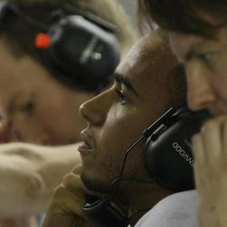 McLaren Formula One driver Lewis Hamilton of Britain watches screens in his team garage following the first practice session for the Singapore Formula One Grand Prix on the Marina Bay City Circuit in Singapore, Friday, Sept. 21, 2012.