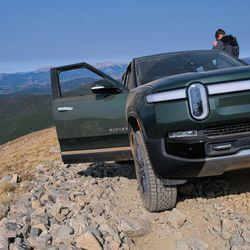 <em>The R1T has a futuristic front, but its bumper and tow hooks (part of the off-road upgrade) still make it look like a truck.</em>