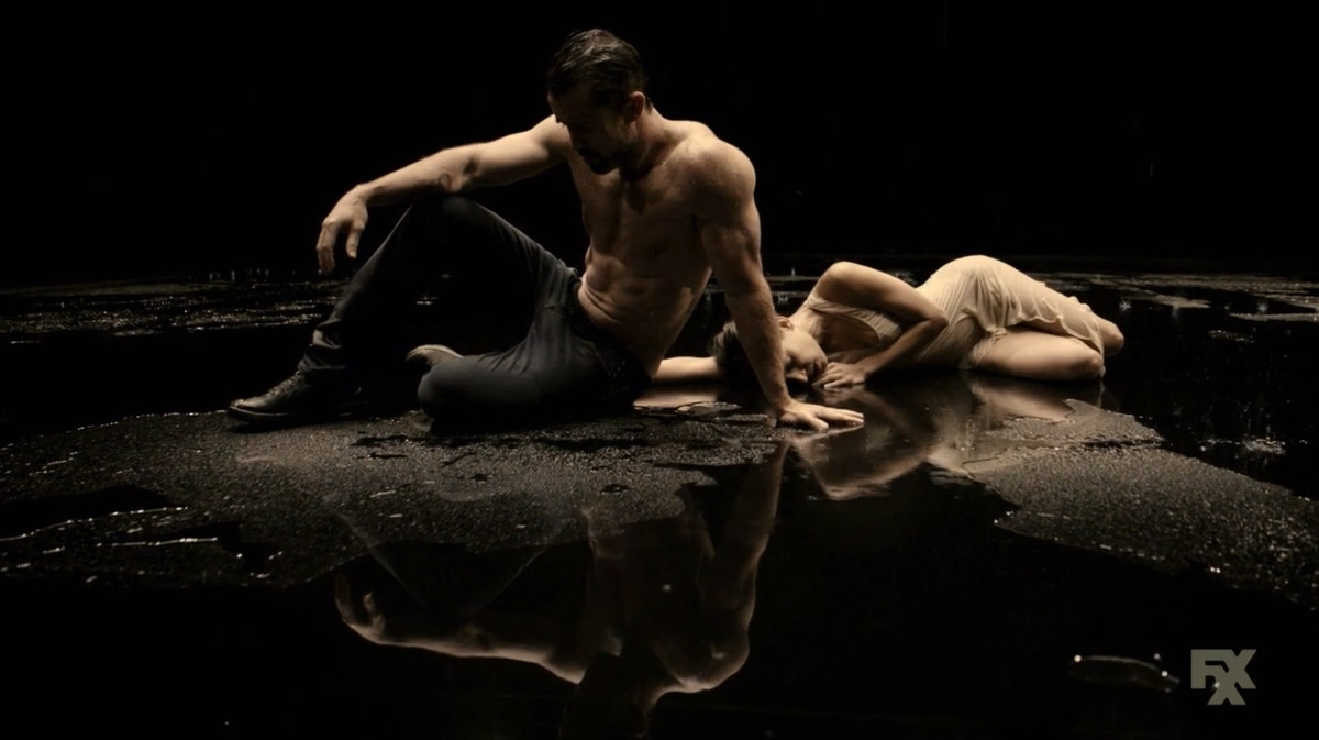 Mac and a female dancer rest during an emotional dance number