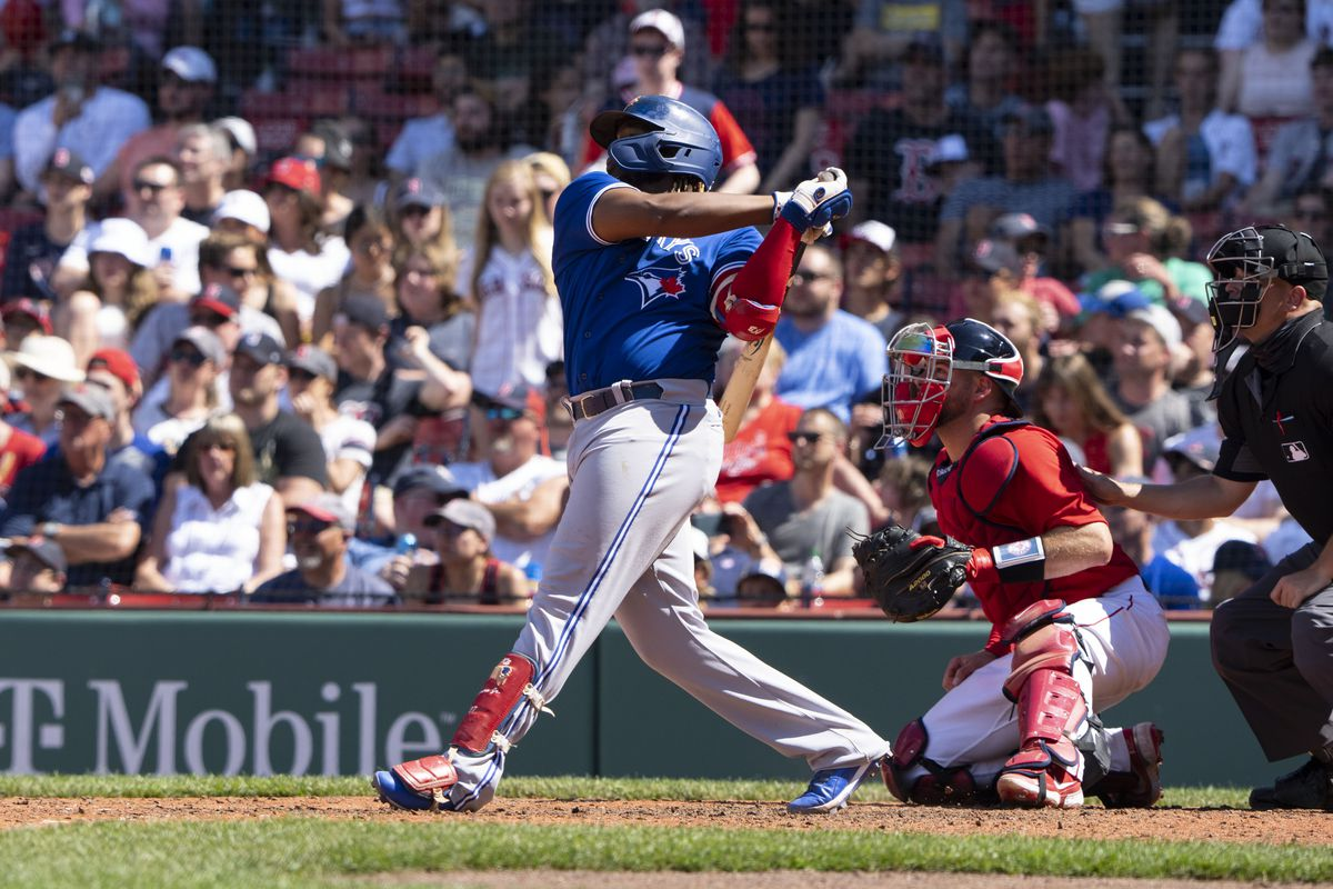 Toronto Blue Jays first baseman Vladimir Guerrero Jr. (27) hits a two run home run during the seventh inning against the Boston Red Sox at Fenway Park.