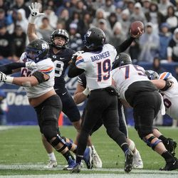 Boise State quarterback Hank Bachmeier (19) throws the ball past BYU defenders during an NCAA college football game at LaVell Edwards Stadium in Provo on Saturday, Oct. 9, 2021.