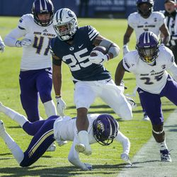 Brigham Young Cougars running back Tyler Allgeier (25) breaks free of the North Alabama defense during a game in Provo on Saturday, Nov. 21, 2020.