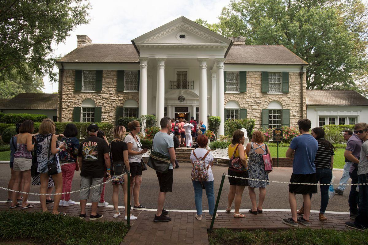 Fans wait in line in 2017 outside Graceland, Elvis Presley's home in Memphis, Tennessee.