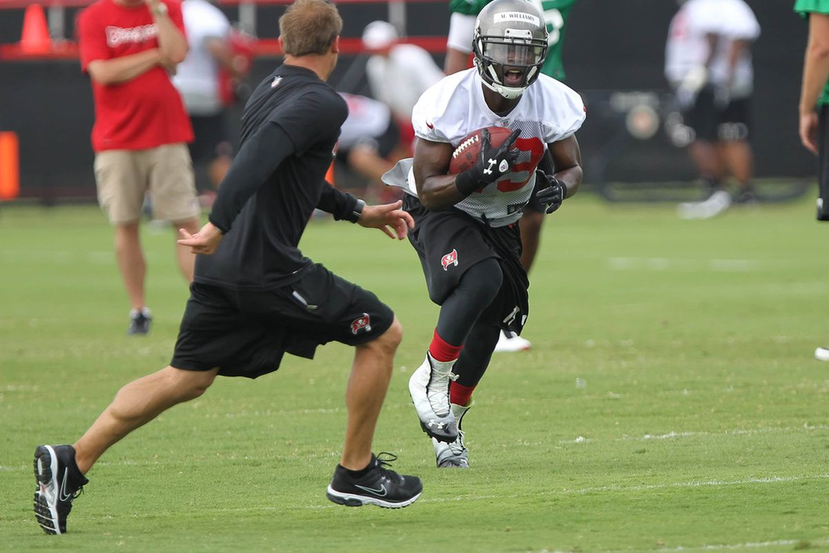 May 15, 2012; Tampa, FL, USA; Tampa Bay Buccaneers wide receiver coach P.J. Fleck defends wide receiver Mike Williams (19) during organized team activities at One Buc.   Mandatory Credit: Kim Klement-US PRESSWIRE
